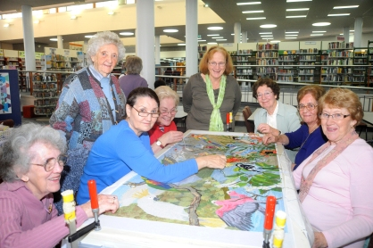 The Creative Embroiderers work on one of the Birds of the WaterWays panels